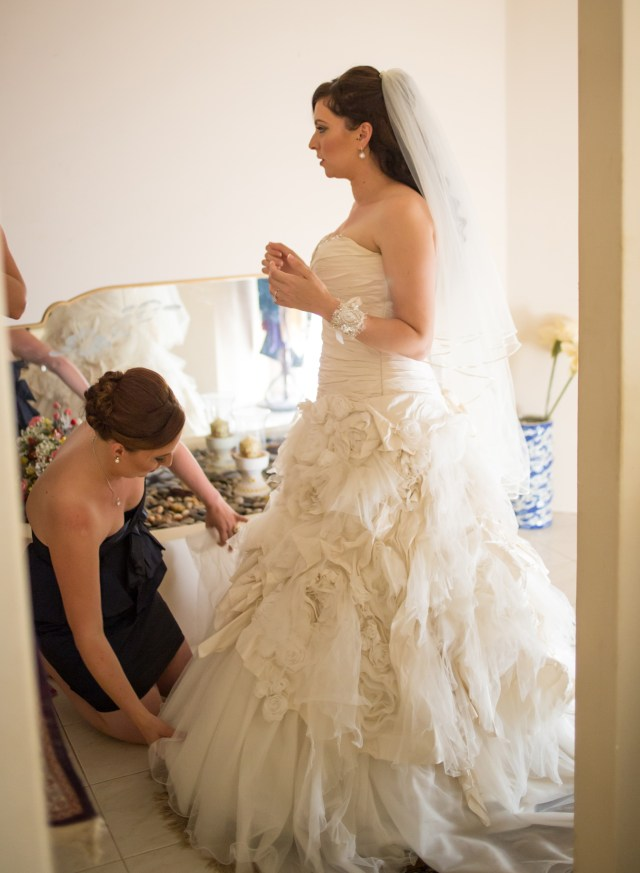 My beautiful matron of honour (my sister) helping me with my dress.