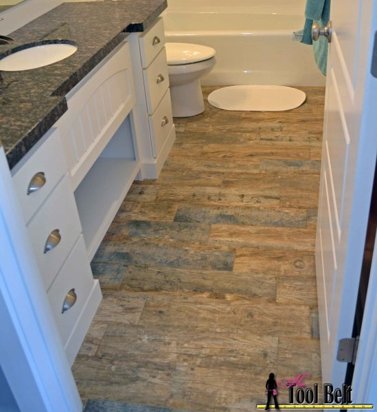 How to install Wood Tile  barnwood    Her Tool Belt Step by step tutorial showing how to install faux barn wood tiles  This tile  looks
