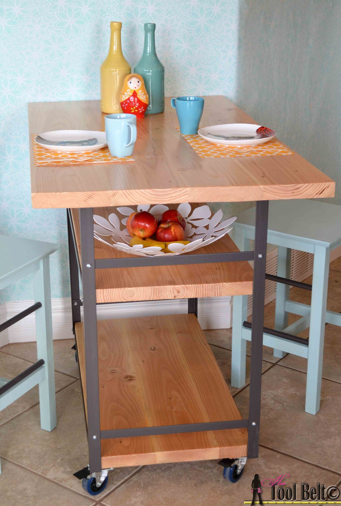 Build a stylish DIY multi-functional table.  Free plans for a rolling industrial counter table, rolling island with lots of open storage.