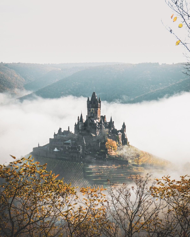 Reichsburg Cochem surrounded by fog