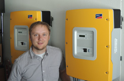 he solar owner Derrick Hoffman standing next to sma battery inverters