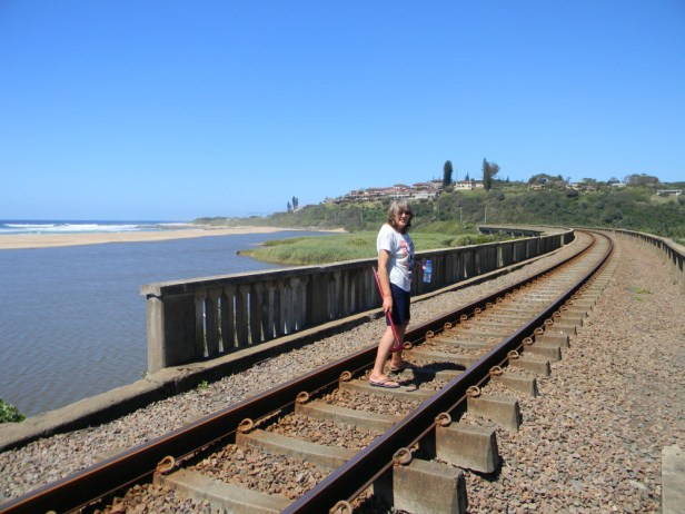 Train bridge over the Mtwalume river with the beach in the background