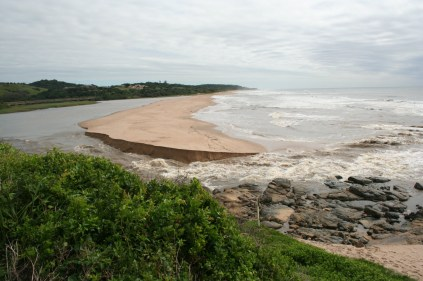 The Mtwalume river lagoon opens into the sea after heavy rains