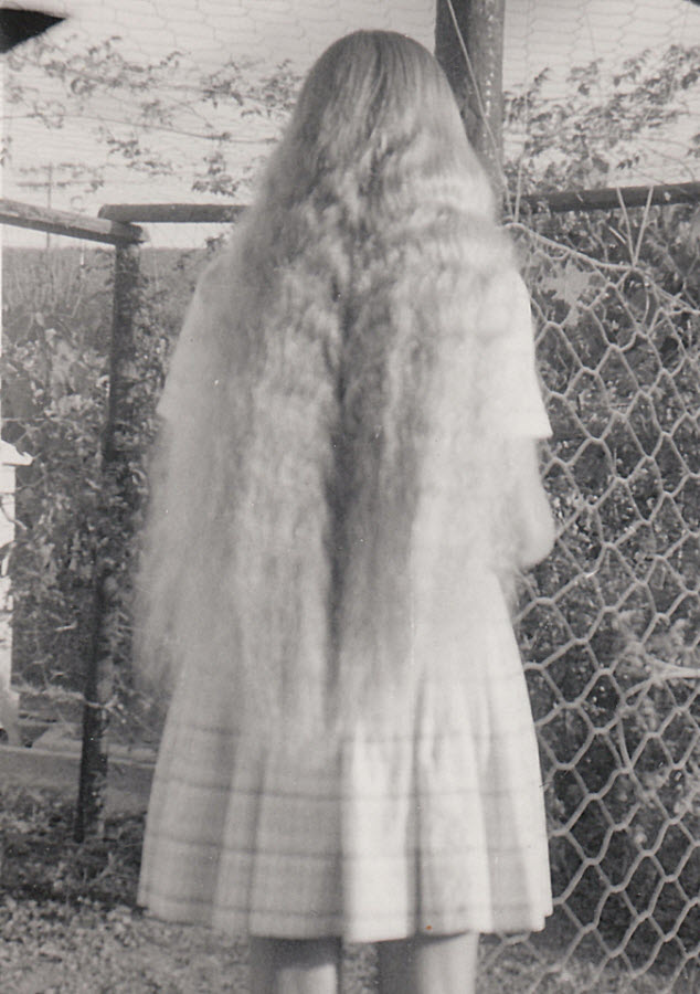 Hester with long hair at age fifteen.