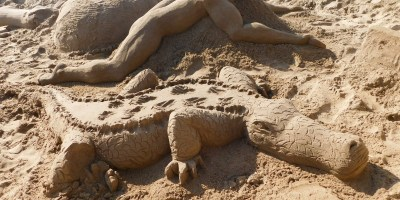 Crocodile, big ape and hippopotamus sand art on St Michaels on Sea Beach in KwaZulu-Natal