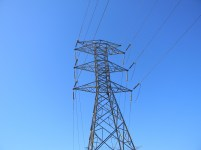 Electric high voltage wires against the backdrop of a clear blue sky