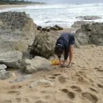 Karen picking up garbage left behind by fishermen at Sea Park