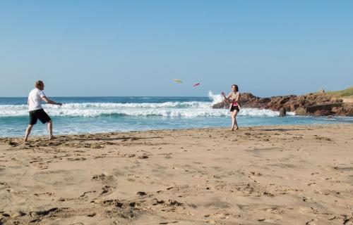 Family fun eith frisbees on Margate Beach