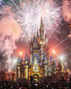 giant fireworks and smoke surround the Disney castle during a lights and fireworks show!