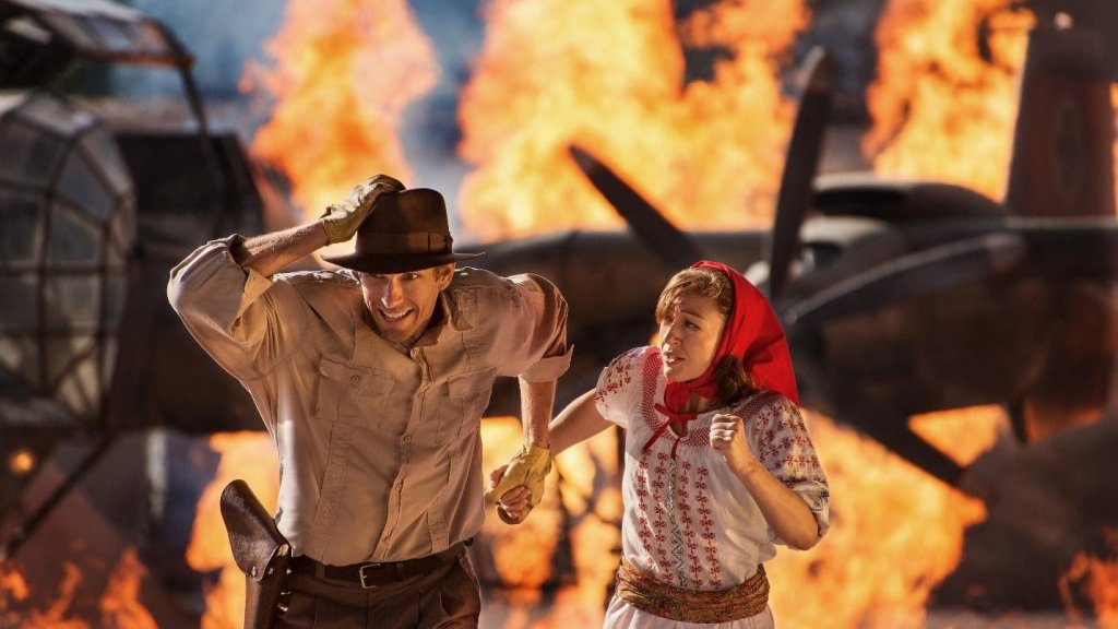 Indiana Jones and a woman running away from fire