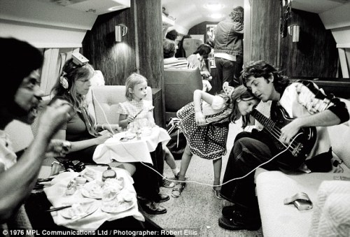 Paul McCartney and family in plane, 1976
