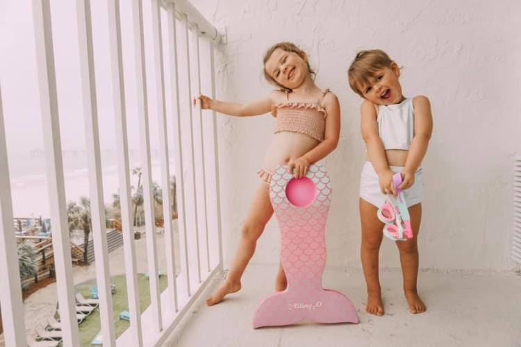beach with kids kick board bling2o