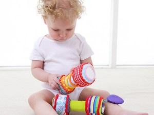 Haltères en peluche pour faire jouer bébé