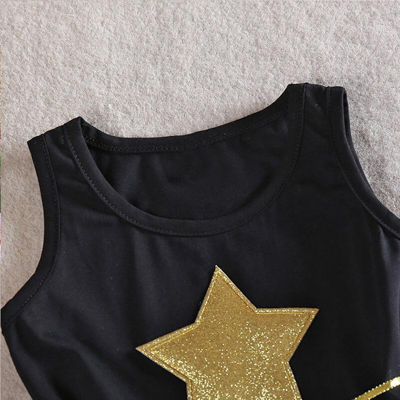 Détails de la robe - Couleur noir - Étoile couleur or brodé sur la robe