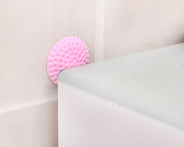 Amortisseur de meubles contre le mur