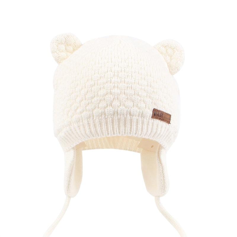 Bonnet bébé blanc écru avec cache-oreilles