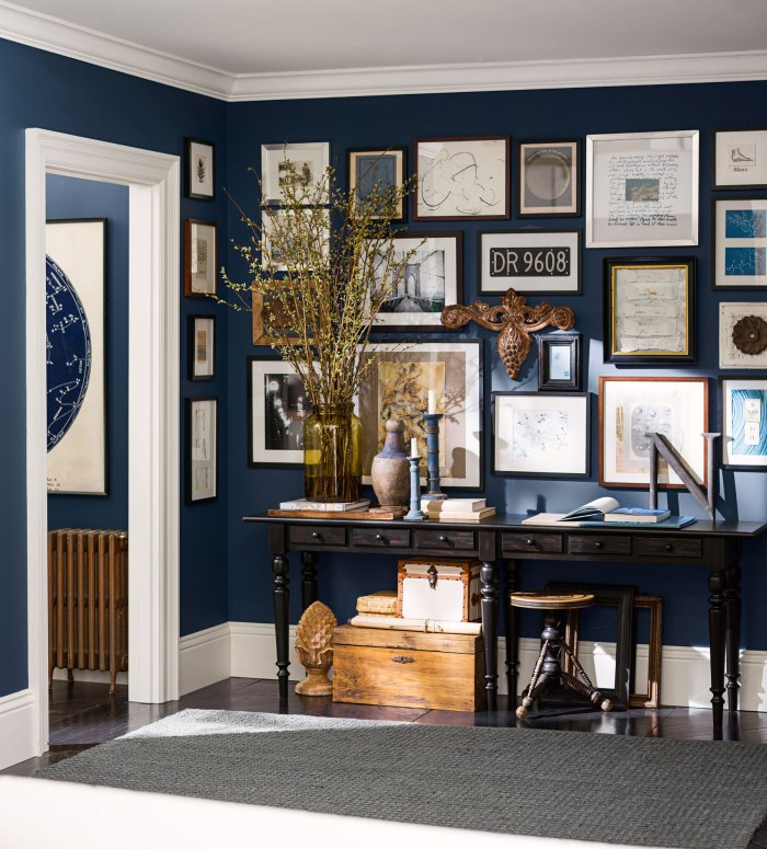 Dark blue entryway room with gallery wall