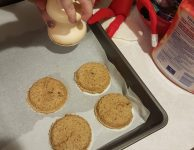 A Christmas elf adds a little magic to cutting the cookies with the Lebkuchen bell.