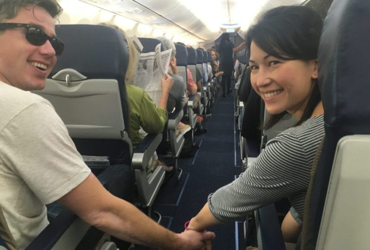holding hands on airplane