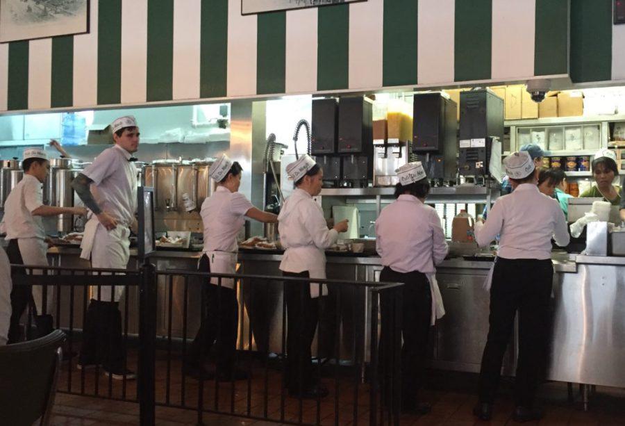 servers at cafe du monde in NOLA