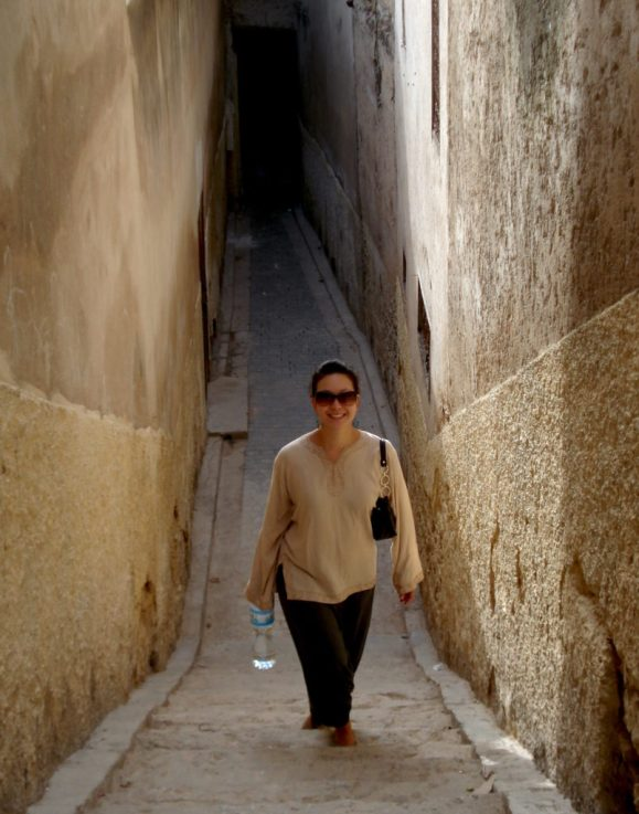 lady walking up stairs in a narrow passage in old city of Fex, Morocco