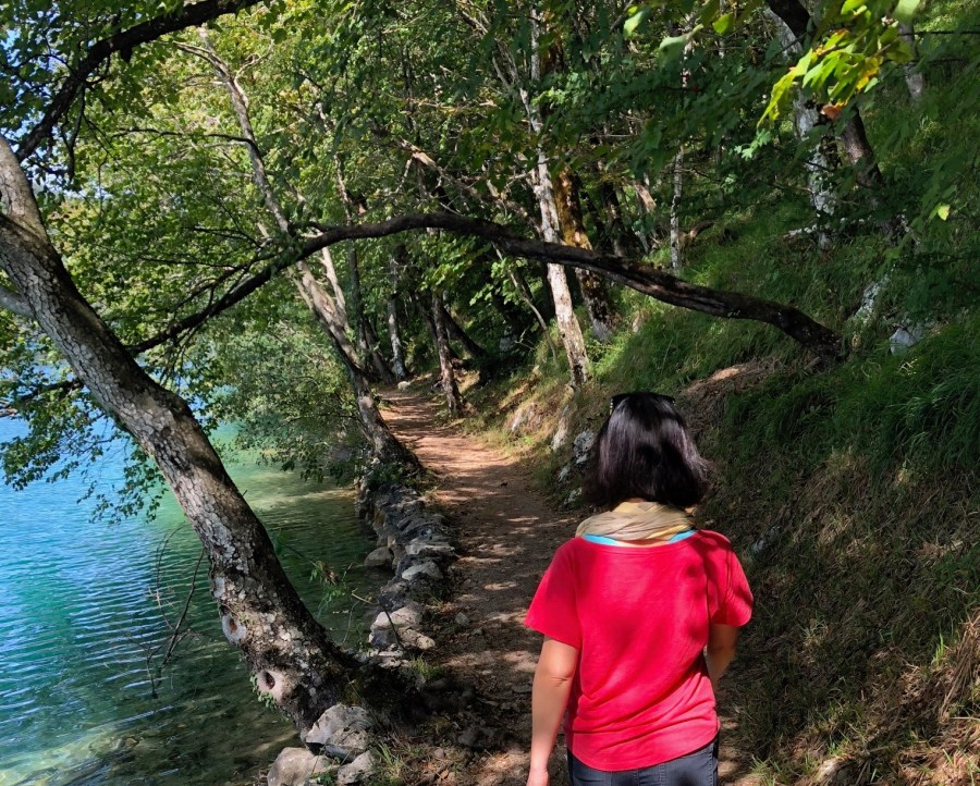 woman walking on lonely trail at Plitvice Lakes National Park, Croatia