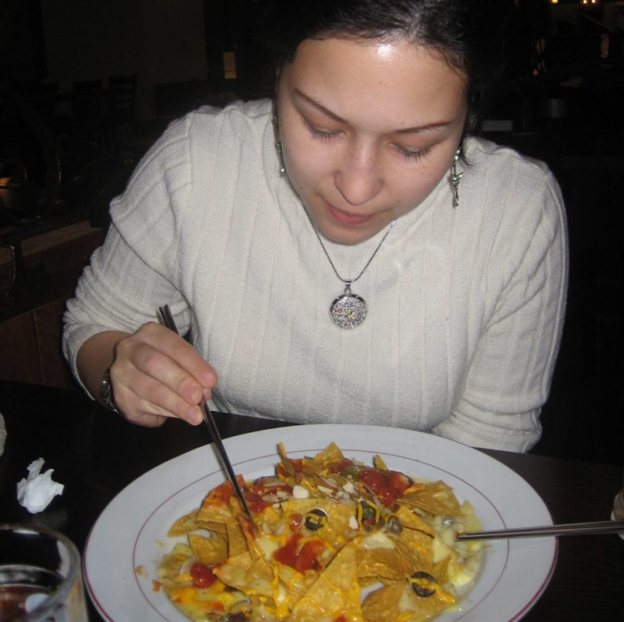 Eating nachos with chopsticks in Seoul, South Korea