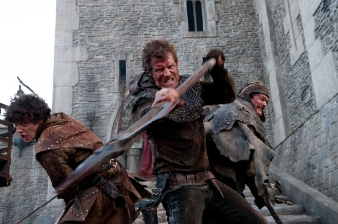 Aneurin Barnard as Guy, Jason Flemyng as Becket, Jamie Foreman as Coteral defend the keep
