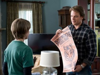 Matt Damon's Benjamin proudly unveils a poster touting the zoo's grand reopening, which features a drawing of a tiger by 14-year-old son Dylan (Colin Ford).
