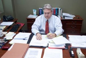 Jed Williams from HSFG sitting at desk