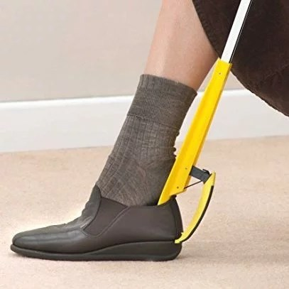 The Helping Hand Shoe Helper claw can grab and hold the shoe in place, whilst the contoured Shoe Horn makes it easy to slide your foot in and out.
