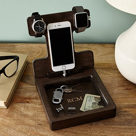 9899f7d75d The Smart Watch Wood Stand serves as a docking station for smartphones and  can hold smart or traditional watches on its wood arm.