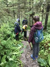 Marlene shows the crew how to clear the streams crossing Bear Paw Lake trail