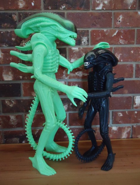 The 24 inch tall glow in the dark Gentle Giant figure compared to the original 18 inch tall Kenner Products Alien.