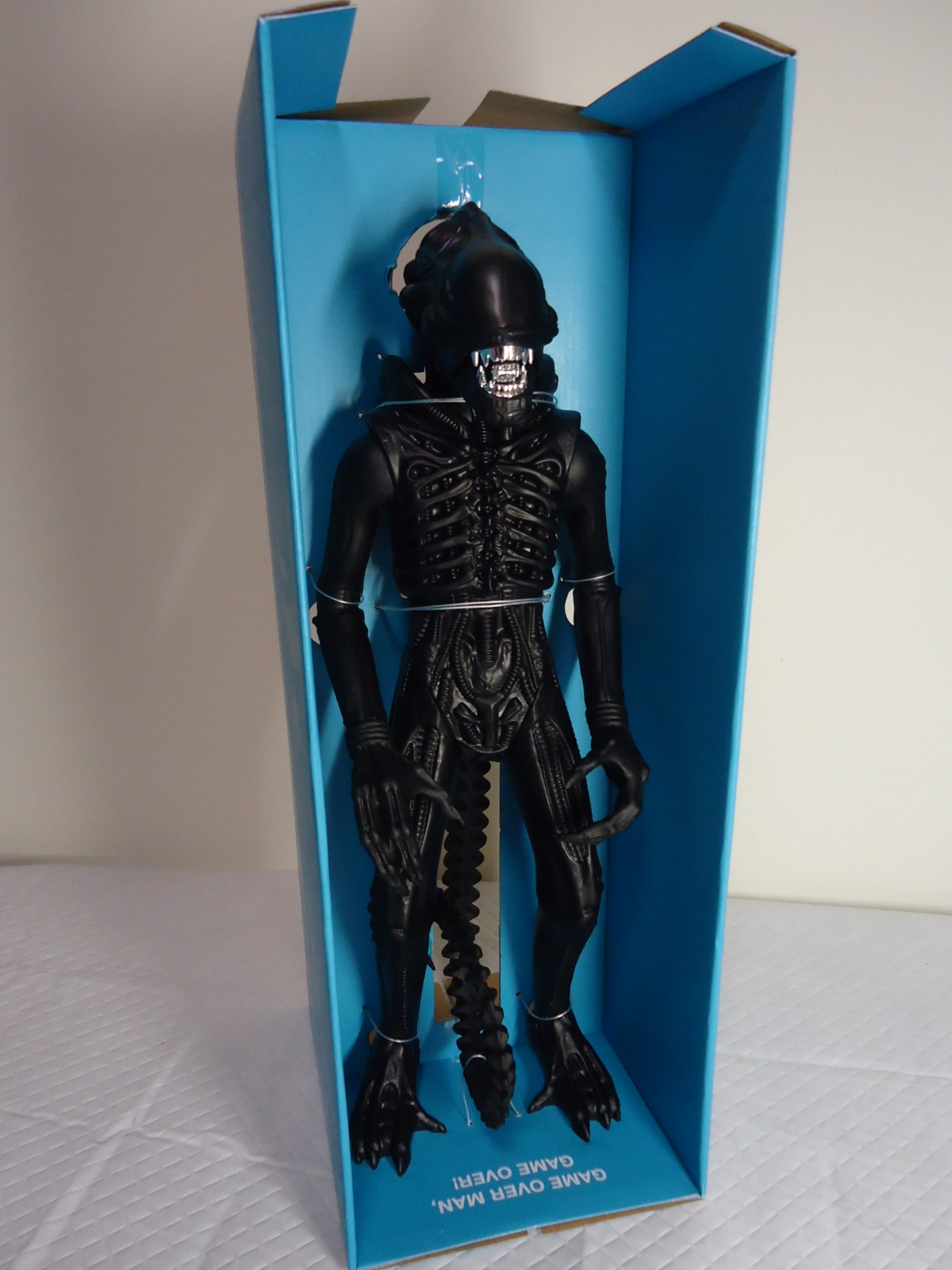 Blue Insert Packaging of the Super 7 1986 'Classic Toy' Edition with Twist Ties Holdling Figure in Place.