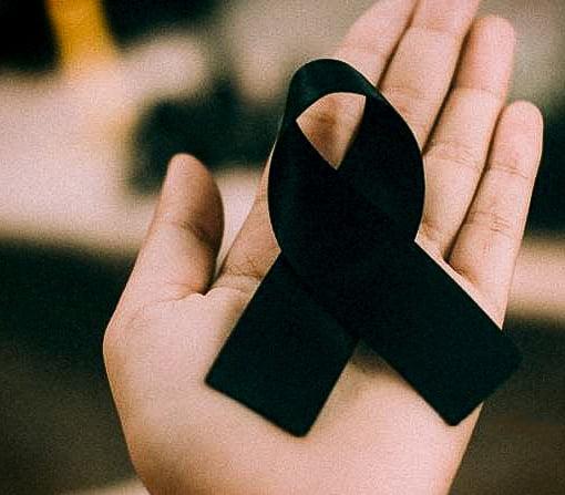 Zwart lint als teken van rouw