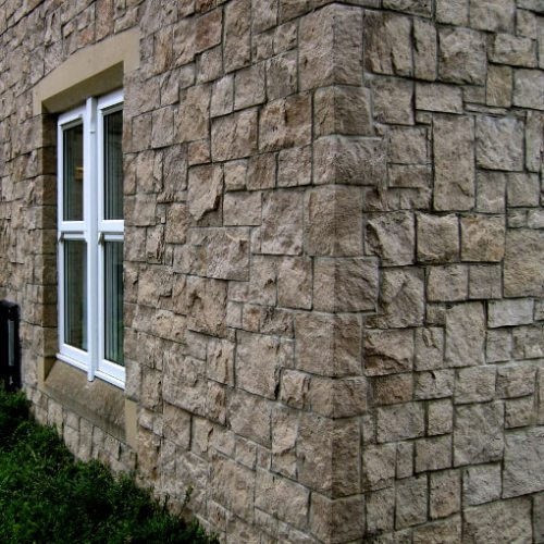 Cast stone corner quoins buff sandstone higgins cladding for Exterior stone cladding panels