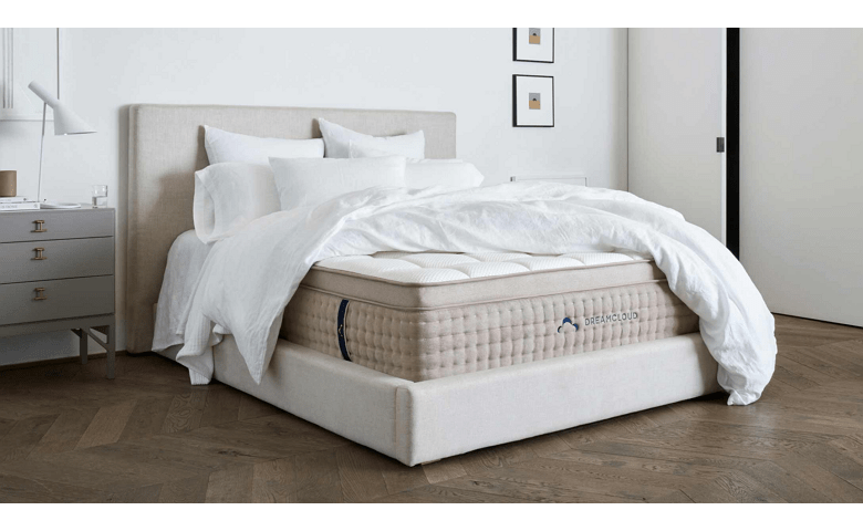 Lying On Bed Side View – DreamCloud Mattress