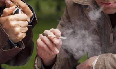 People smoking maijuana from a one hitter