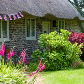 A Thatched covered cottage