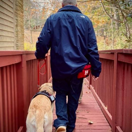 steve chase walking with mickey service dog