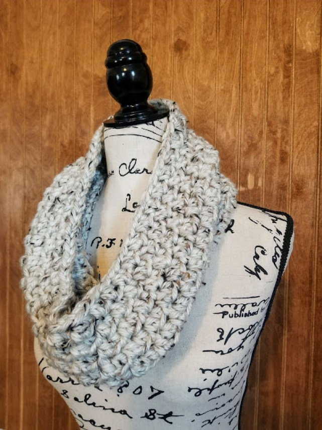 aspen tweed scarf. linen colored infinity scarf on a mannequin