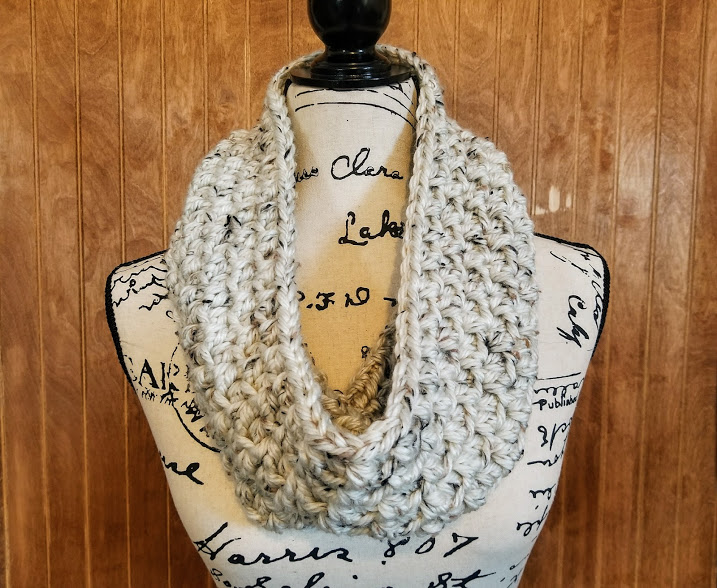 aspen tweed scarf. linen colored scarf on a mannequin.