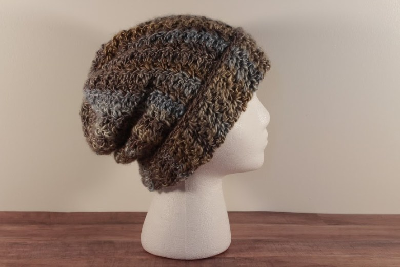 casual friday slouch hat shown in blue/grey version on a styrofoam head. side view