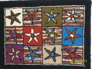 Rug I started at Amy Oxford's punch needle class in Vermont back in 2008. I did finish it. :)