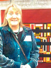 Tapestry artist Donna Loraine Contractor in her booth at the 2015 RIo Grande Arts and Crafts Festival (Thanksgiving weekend).