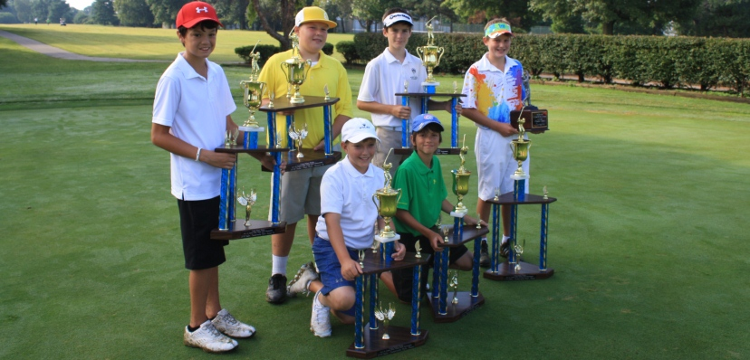 Junior golfers with Trophies