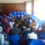 Delegates discussing solutions to identified problems in the state