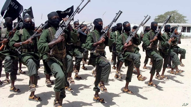 Hundreds of newly trained al-Shabab fighters perform military exercises in the Lafofe area some 18 km south of Mogadishu, in Somalia, Feb. 17, 2011.
