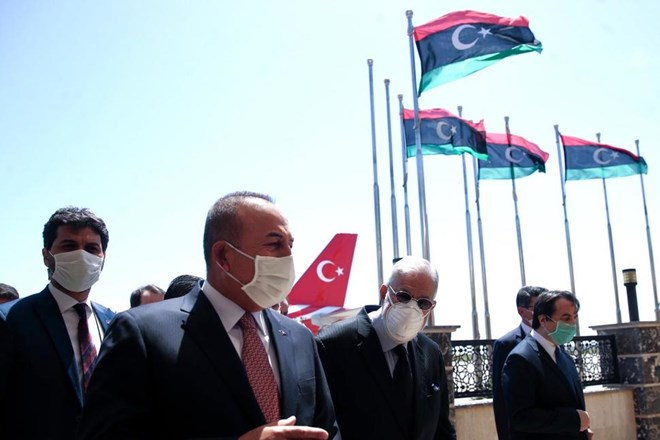 In this June 17, 2020, file photo, Turkey's Foreign Minister Mevlut Cavusoglu, left, and Muhammed Tahir Siyala, Foreign Minister of Libya's internationally-recognized government, speak at the airport, in Tripoli, Libya. Libya's eastern-based forces have lost the chance to engage in a political solution to the North African country's conflict, Turkey's foreign minister said Saturday, June 20, 2020. (Fatih Aktas/Turkish Foreign Ministry via AP, Pool, File)